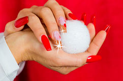 Red nails decorated for your fantastic Christmas Royalty Free Stock Images