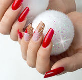Red nails decorated for your fantastic Christmas Royalty Free Stock Photography