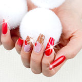 Red nails decorated for your fantastic Christmas stock photos