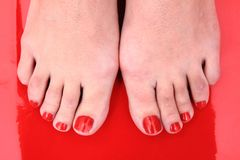 Red nails on the feet Royalty Free Stock Photography