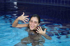 Red nails on pool Royalty Free Stock Photo