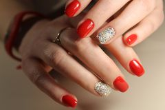 Red nails with rhinestones stock photography