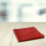 Red napkin on an empty wooden counter Royalty Free Stock Images