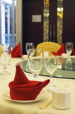 Red napkin on the table. Red napkin on a table in a restaurant Royalty Free Stock Photos