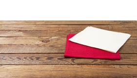 Red Napkin. Tablecloth tartan, checkered, dish towels on white wooden table background top view closeup royalty free stock photos