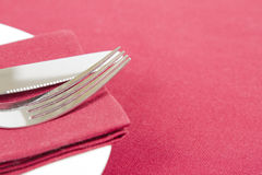 Red napkin on white plate Stock Photography