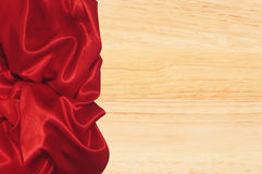 Red napkin on wooden table Royalty Free Stock Photo