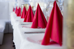 Red napkins for table layout. Red napkins for table setting in restaurant royalty free stock image