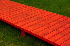 Red narrow path over the grass Royalty Free Stock Photography