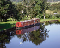 Red Narrowboat moored at Tewitfield Stock Photography