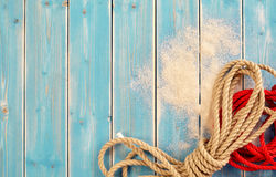 Red and Natural Bundles of Rope on Blue Wood Stock Photo