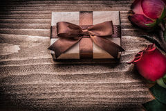 Red natural roses present box on wooden board Royalty Free Stock Image