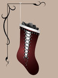 Red naughty stocking with coal Royalty Free Stock Image