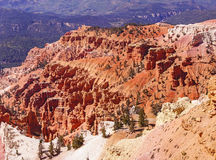 Red Navajo sandstone pinnacles. Eroded red Navajo sandstone pinnacles and cliffs Cedar Breaks National Monument, Utah royalty free stock photo