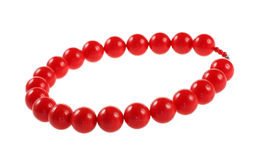 Red necklace. Beads necklace on white background royalty free stock image