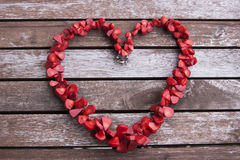 Red necklace in the form of heart. On the wooden surface Royalty Free Stock Image