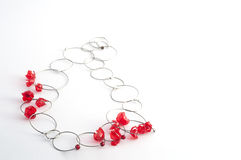 Red necklace with wire bicycle Stock Images