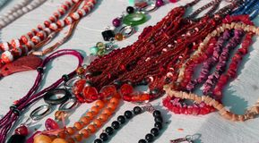 Red necklaces with other jewelry for sale in the vintage shop Stock Photography