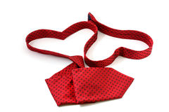 Red necktie forming two heart Royalty Free Stock Photos