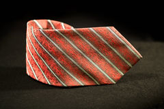 Red necktie over black background Royalty Free Stock Images