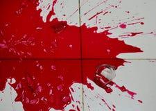 Red nectar concentration splash on floor after bottle broken Stock Photos
