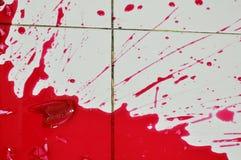 Red nectar concentration splash on floor after bottle broken Royalty Free Stock Photo