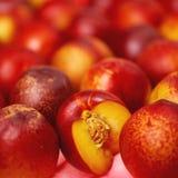 Red nectarines. Fresh red juicy nectarines closeup royalty free stock image