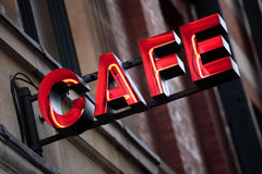 Red neon cafe sign, illuminated at night Stock Photo