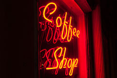Red Neon Coffee Shop sign left side version. Coffee Shop sign in red neon lighting on a black background at an angle. Also available in a straight-on version Stock Photo