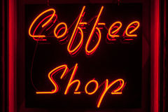 Red Neon Coffee Shop sign straight-on version. Coffee Shop sign in red neon lighting on a black background. Also available in left and right angles Stock Photo