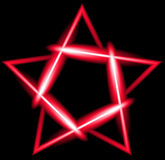 Red neon five-pointed star, black background Royalty Free Stock Photos