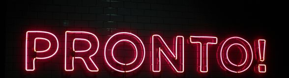 Red neon lights writing in italian pronto ready in english Royalty Free Stock Photo