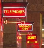 Red Neon Sign Indoor Depot Signage Arrow Points Baggage Phone Royalty Free Stock Images