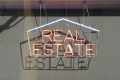 Real Estate Sign. A red neon sign that reads Real Estate stock images
