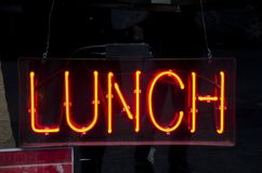 Neon Lunch Sign. A red neon sign in a restaurant window advertises lunch available inside royalty free stock images