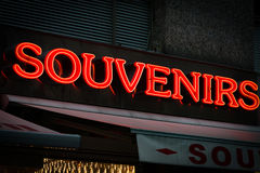 Red neon sign on souvenirs shop in Vienna, Austria Royalty Free Stock Photos