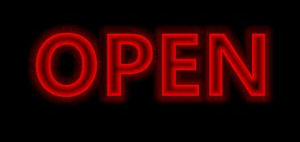 Neon red open sign. A red Neon sign which says open sign in blue with fluorescent light A neon open sign glowing blue in the window of a restaurant Stock Image