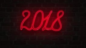 Red Neon signboard 2018 happy new year lighting up against a Brick wall stock illustration