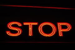 Red Neon Stop Sign Stock Photo