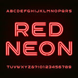 Red neon tube alphabet font. Type letters and numbers. Royalty Free Stock Photo