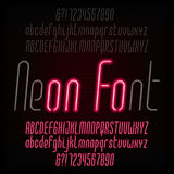 Red neon typeface. Light turn on and off. Modern oblique alphabet. Royalty Free Stock Images