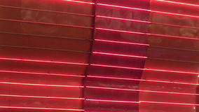 Red Neon Wall Loop. A solid red wall of chasing neon stock footage