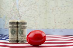 Red nest egg reflects problems in American economy at larger geo. Red nest egg reflects problems in American financial and trade policy on larger geographical royalty free stock photos