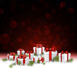 Red New Year background with gifts. Stock Photos