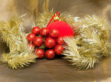 Red New Year  ball, decorative berries and tinsel.Christmas still life Stock Photography