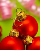 Red new year balls on green background. MERRY CHRISTMAS. WEB BANNER. New Year`s composition stock image