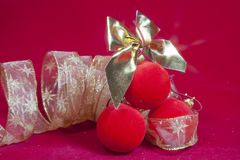Red New Year balls and ribbon Stock Photos