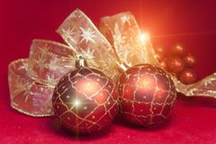 Red New Year balls and ribbon Stock Images