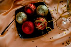 Red New Year Decorations Christmas balls. New Year Decorations Christmas balls, red and golden on golden background stock images