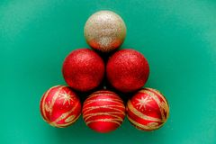Red New Year Decorations Christmas balls. New Year Decorations Christmas balls, red and golden on green background stock photography
